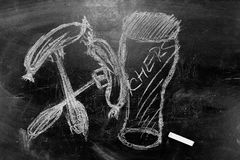 A picture of a glass of beer with chalk on blackboard Royalty Free Stock Photos
