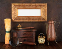 Picture gold frame. With ancient subjects. Still-life stock photo