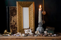 Picture gold frame and candle . Still-life royalty free stock photos