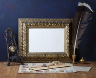 Picture gold frame and quill pen Stock Photo