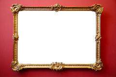 Picture gold frame on red painted wall Royalty Free Stock Photography