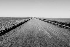 Gravel road in black and white Royalty Free Stock Image