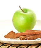 Picture of green apple (focus on cinnamon) Royalty Free Stock Image