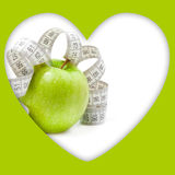 Picture of green apple and measure tape Stock Photo