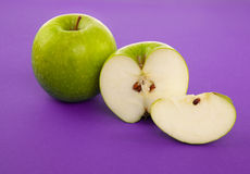 Picture of green apple on violet Stock Photo