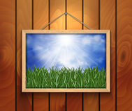 Picture with green grass, sky and cloud. Illustration of picture with green grass, blue sky and clouds on wooden background Royalty Free Stock Photo