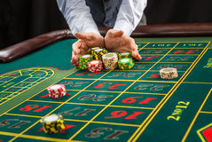 Picture of a green table and betting with chips. Stock Images