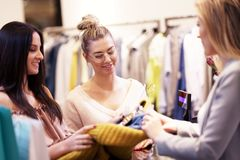 Picture of group of happy friends shopping for clothes in mall stock photos