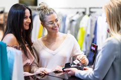 Picture of group of happy friends shopping for clothes in mall royalty free stock photos