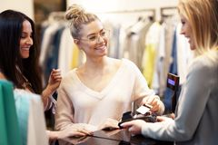 Picture of group of happy friends shopping for clothes in mall stock photo