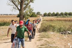 Refugees walking through the fields near the Croatia Serbia border, between the cities of Sid Tovarnik on the Balkans Route. Picture of a groupe of family of royalty free stock image