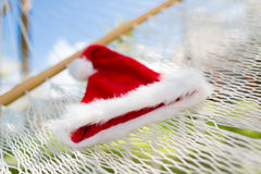 Picture of hammock with santa helper hat Royalty Free Stock Photo