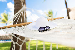 Picture of hammock with white hat and sunglasses Stock Images