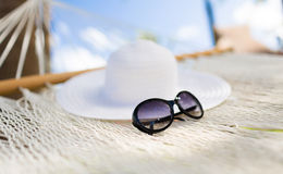 Picture of hammock with white hat and sunglasses Stock Photography
