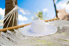 Picture of hammock with white hat Royalty Free Stock Image
