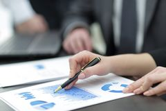 Close-up of male and female hands pointing at business document. Picture of hands of business people pointing at documents Stock Photography