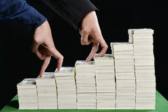 Picture of hands and fingers that represents a business competition. stock photography