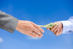 Picture of hands giving and receiving dollar bills Royalty Free Stock Image