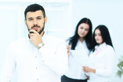Picture of handsome businessman with team in white office Stock Photo