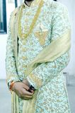 Picture of handsome groom dressed in rich ethnic Indian style. For a wedding royalty free stock image