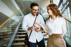 Picture of handsome man and beautiful woman as business partners Stock Images