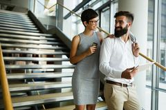 Picture of handsome man and beautiful woman as business partners. Picture of handsome men and beautiful women as business partners standing outside Royalty Free Stock Image