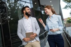 Picture of handsome man and beautiful woman as business partners royalty free stock photo
