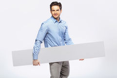 Picture of handsome man in suit with a blank board Royalty Free Stock Photo