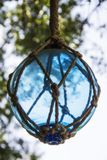 Hanging blue glass globe. A picture of a hanging blue glass globe on a front porch stock photography