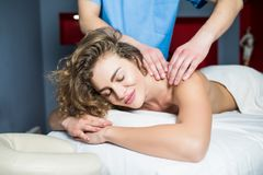 Picture of happy beautiful woman relax in massage salon stock photo