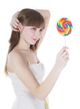 Picture of happy blonde with color lollipop Royalty Free Stock Photography