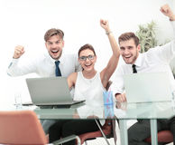 Picture of happy business team celebrating victory in office Royalty Free Stock Photography
