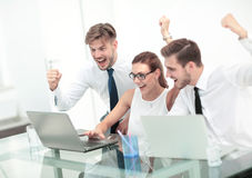 Picture of happy business team celebrating victory in office Stock Image