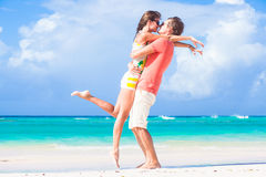Picture of happy couple in sunglasses hugging on Stock Images