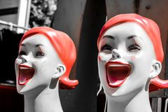 Happy faces on mannequins Royalty Free Stock Images