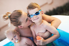 Picture of happy family in swimming pool. Picture of happy family in small swimming pool Royalty Free Stock Images