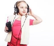 Picture of happy girl in big headphones Stock Photos