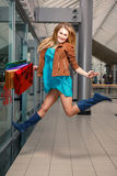 Picture of happy girl with shopping bags Royalty Free Stock Image