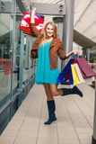Picture of happy girl with shopping bags Royalty Free Stock Photos