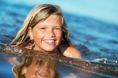 Picture of a happy girl in the water Royalty Free Stock Image