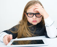 Picture of little girl with tablet PC computer. Picture of happy little girl with tablet PC computer Stock Image