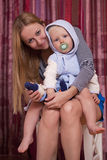 Picture of happy mother with adorable baby boy Royalty Free Stock Image