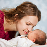 Picture of happy mother with baby in bedroom Stock Photography