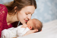 Picture of happy mother with baby in bedroom Royalty Free Stock Images