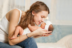 Picture of happy mother with baby in bedroom Stock Images