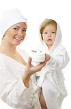 Picture of happy mother with baby holding cream stock image