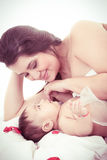 Picture of happy mother with baby over white Royalty Free Stock Images