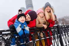 Picture of happy parents with daughter and son on winter walk. At bridge Stock Images