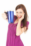 Picture of happy teenage girl with blue mug Stock Images