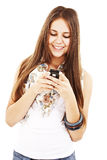 Picture of happy teenage girl with cell phone Royalty Free Stock Images